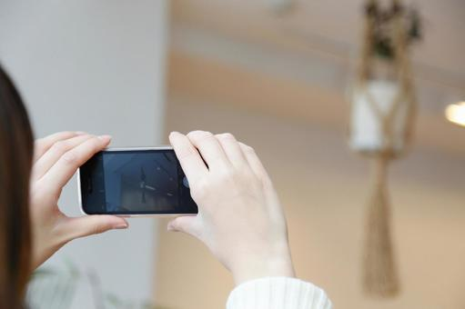 A person taking a picture with a smartphone 1