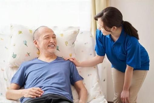 Smiley caregiver and the elderly