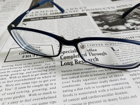 English newspaper and glasses
