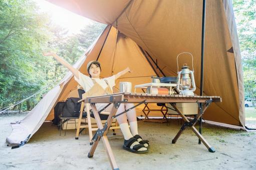 A woman enjoying a solo camp