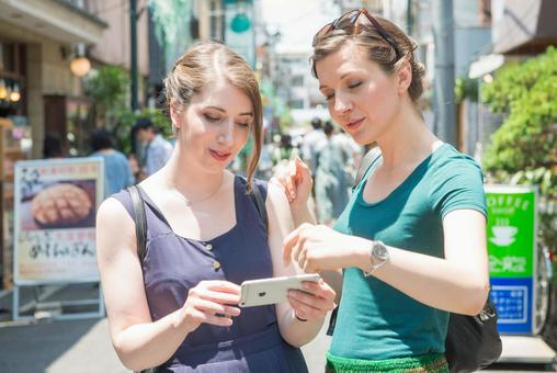 Female foreign tourist using a smartphone 2