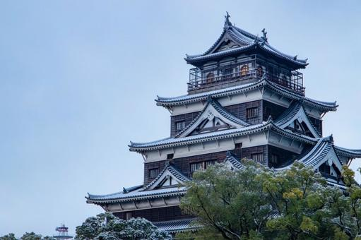 Hiroshima Castle with snow in the early morning of winter