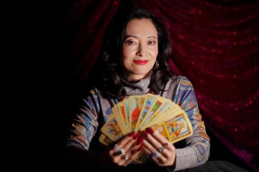 Female fortune teller with tarot cards