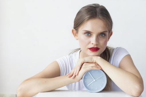 Table clock and woman