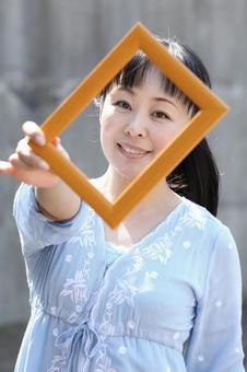 A woman with a frame