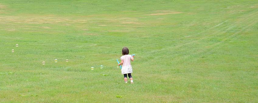 Girl playing bubbles