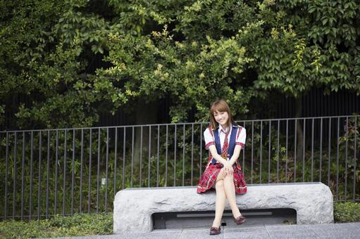 A woman sits on a bench 1