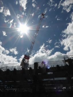 A crane towering in the backlight