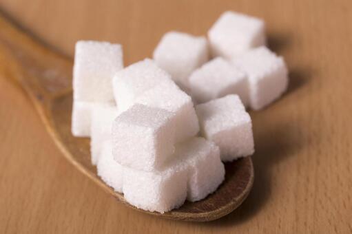 Cube sugar on spoon 1