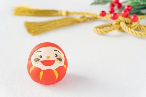 Fukudaruma with a smile and Japanese string of gold Nanten