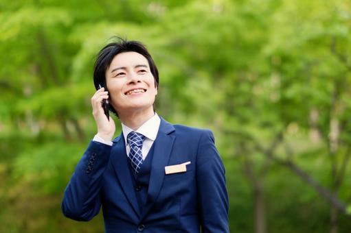 Hotel Man 10 using a smartphone