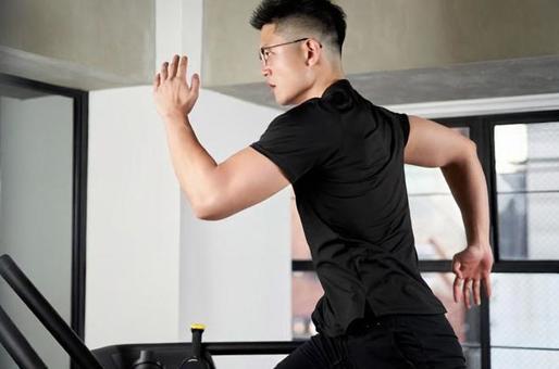 Asian man running on a treadmill in a training gym