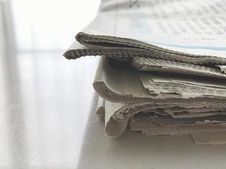 Multiple newspapers on the table