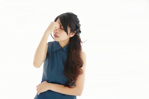A Japanese woman suffering from a headache 5