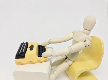 Typewriter and wooden doll (white background), work / telework image