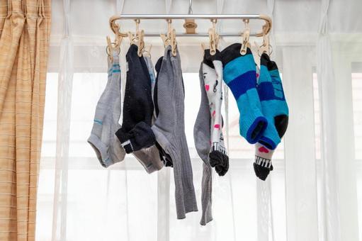 Socks hung by the window