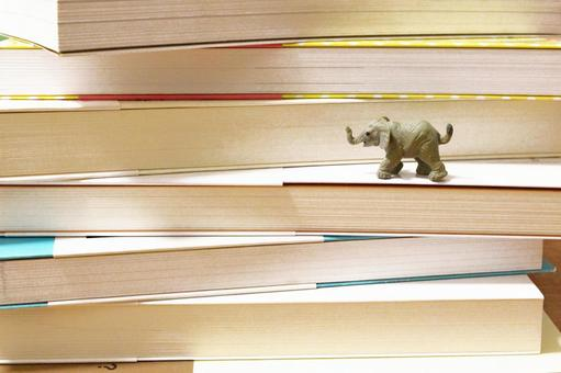 Stacked books and cute elephants 2