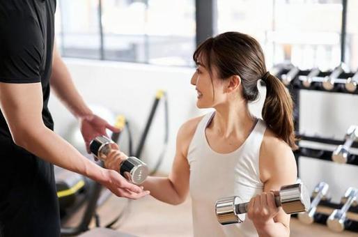 Asian women receiving dumbbell training guidance