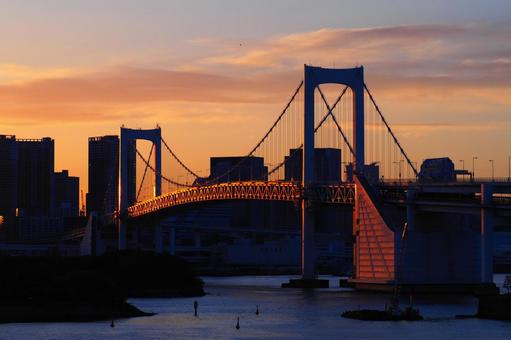 Rainbow bridge illuminated by the setting sun