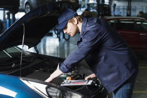 Automobile mechanic checking bonnet 9