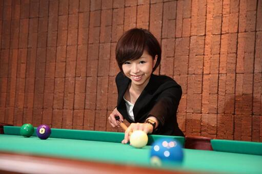 Female employee playing billiards 1