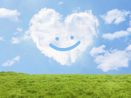 미소와 하트 모양 구름과 초원