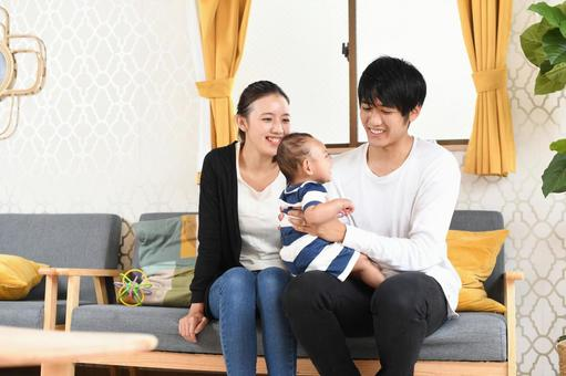 Smiley father, mother and child (baby)