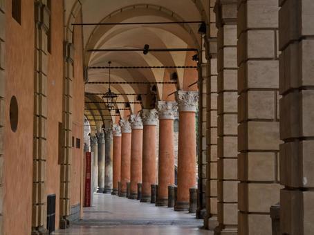 A corridor with corridor with Bologna sculpture