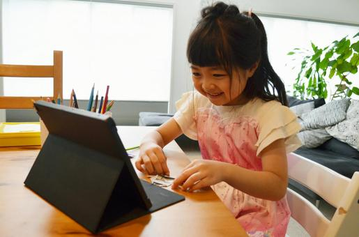 Origami looking at a girl tablet
