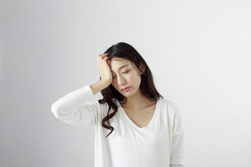Japanese women suffering from headache 2