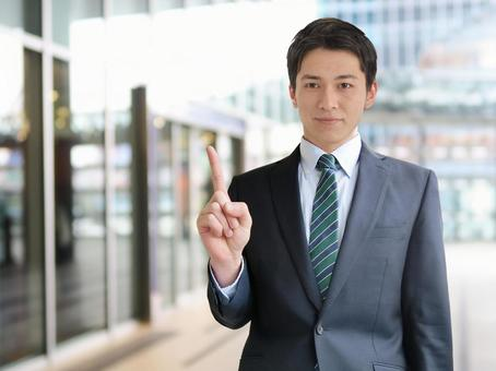 Business man pointing to business point-business background