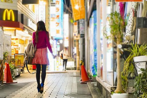 Woman walking in downtown_back view