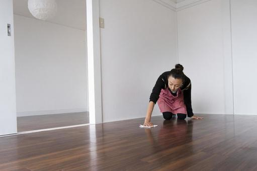 Woman cleaning the room