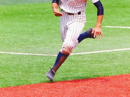 A runner dashing toward a high school baseball parts home aiming for a goodbye score