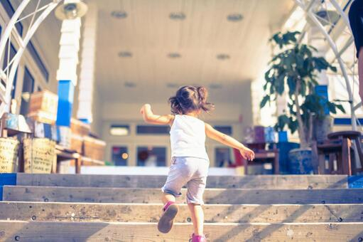 A child running up the stairs
