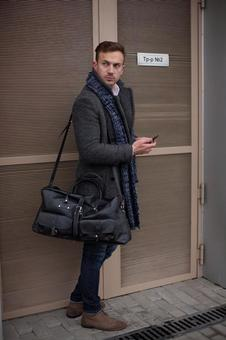 Male model 8 posing with a bag