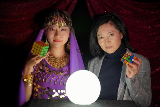 Fortune-teller and female customer with Rubik's cube