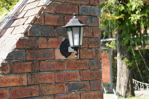 Brick wall and street light