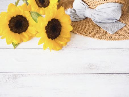 Image of summer Sunflower and straw hat