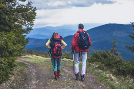Trekker's couple walking on the mountain path 11