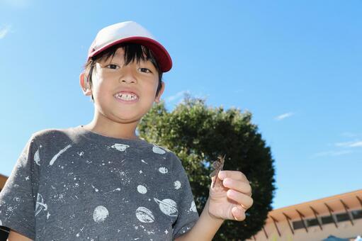 Boy catching dragonfly