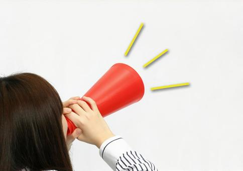 A woman shouting at the megaphone