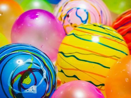 Colorful yo-yos and water balloons
