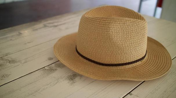 A straw hat placed on a wooden table