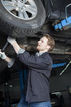 Automobile mechanic servicing tires 8
