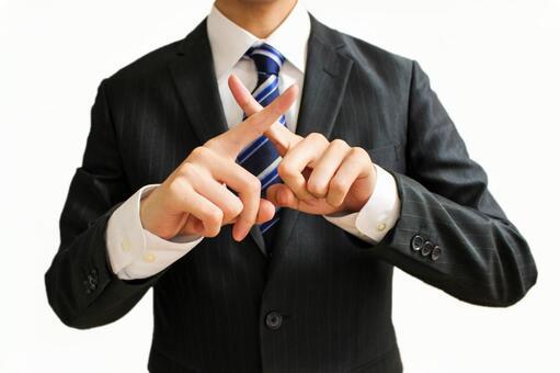 Businessman making cross marks