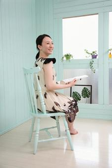 Woman sitting in a chair and reading a book 6