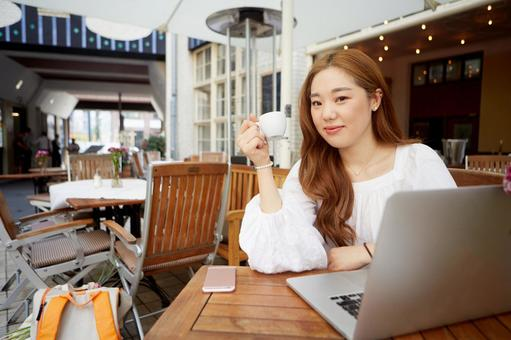 Asian woman 3 using laptop in cafe
