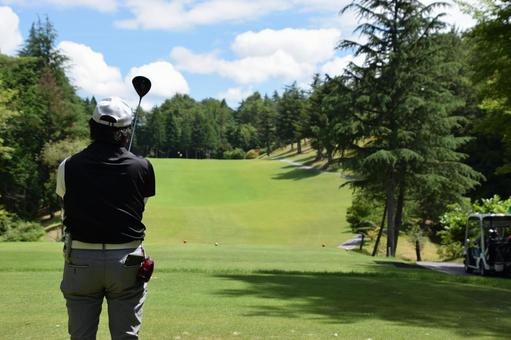 A man checking the hitting direction on a golf course