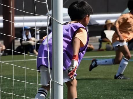 Soccer boy, keeper is lonely